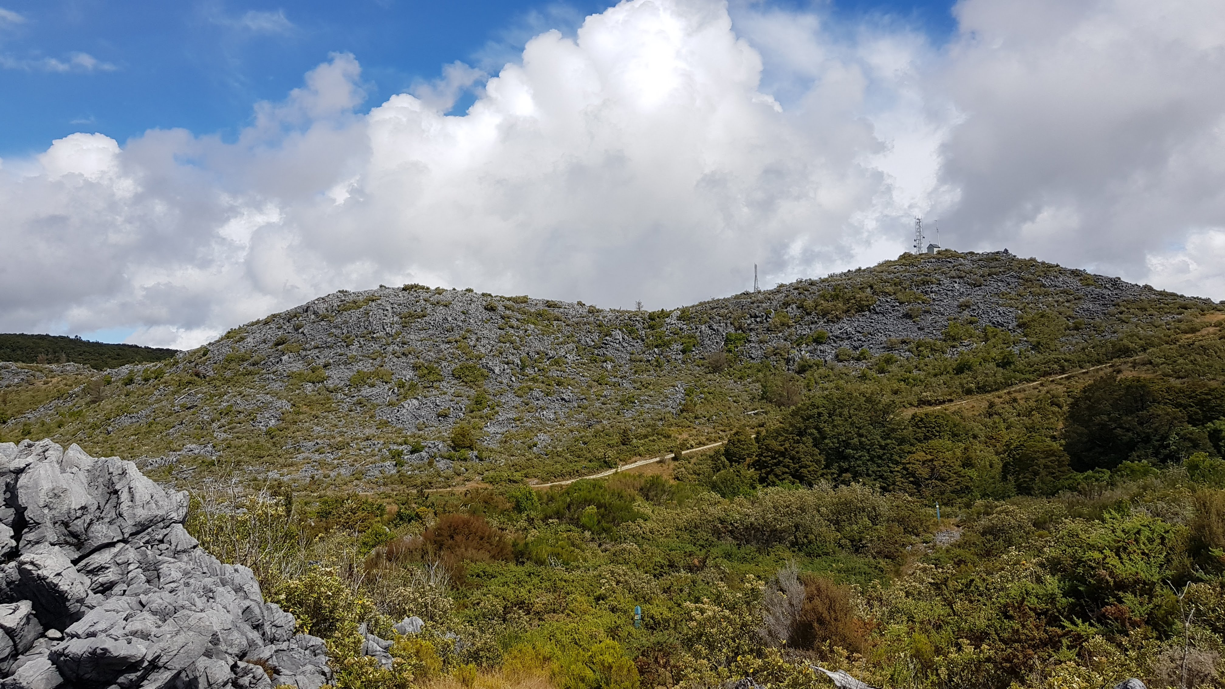 A four wheel drive track to the summit