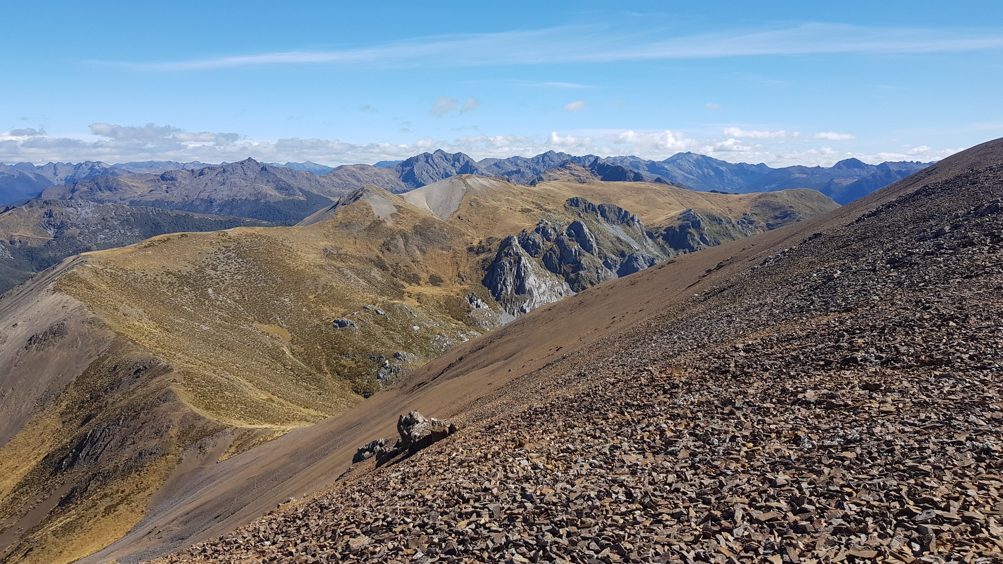 Walking a decent scree slope towards Mount Peel