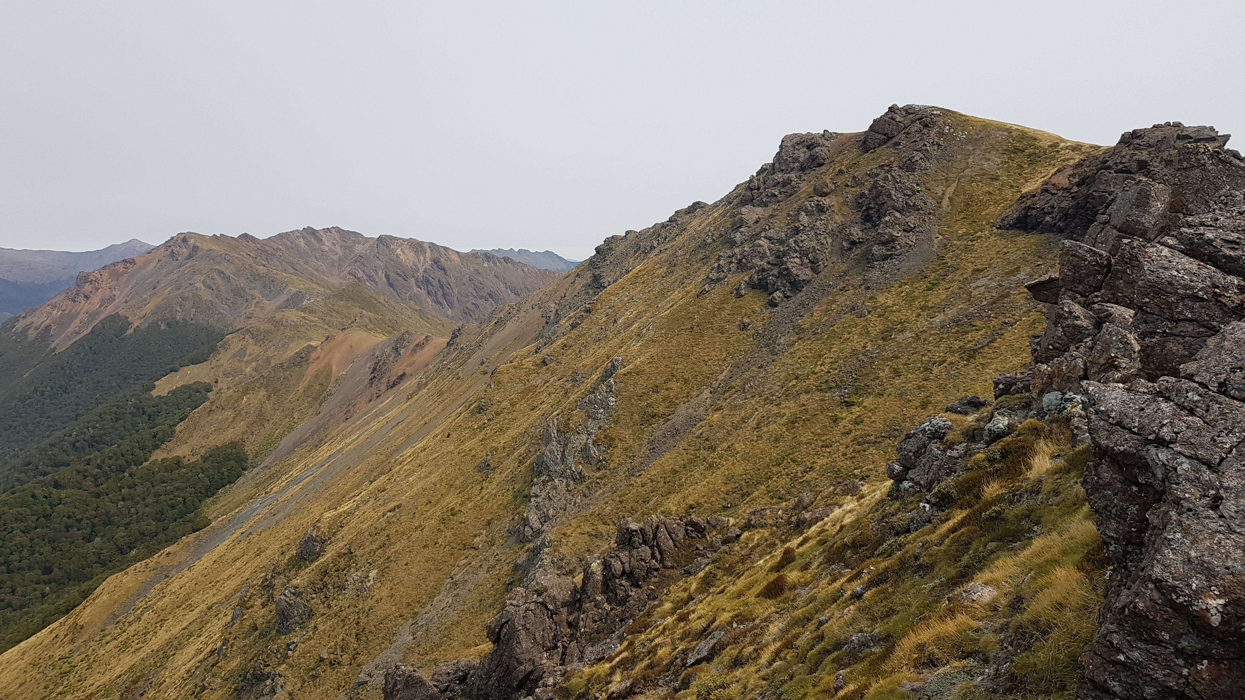 Traversing some of the rocky outcrops along the ridge of the Lockett Range