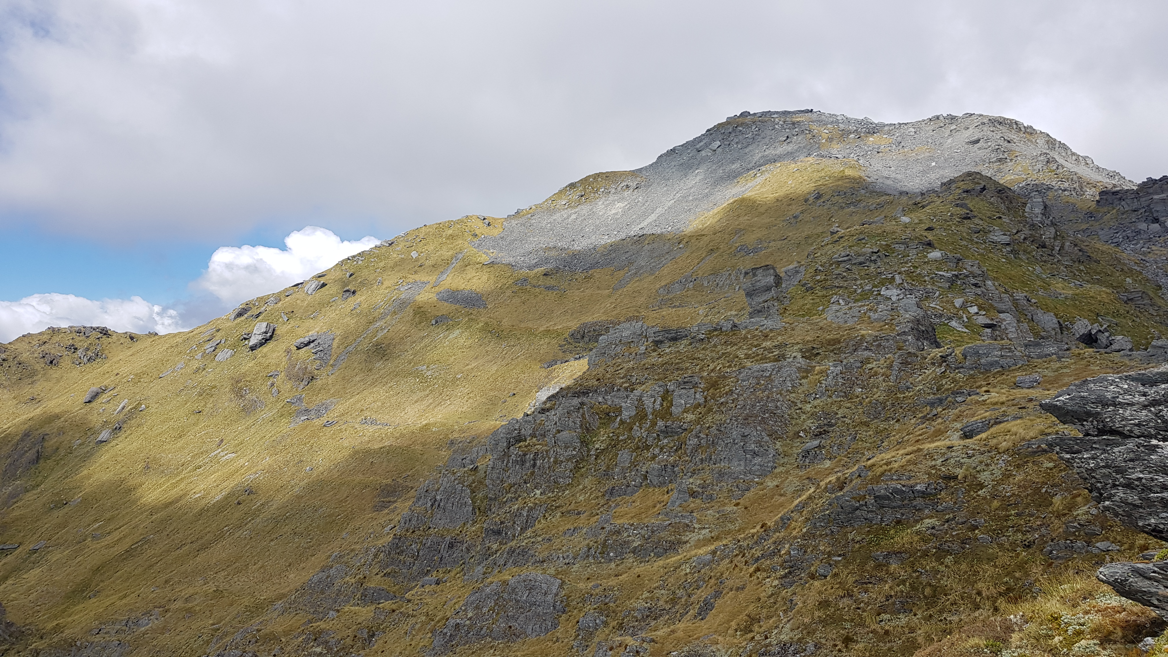 Heading up to the 1795m point ' Little Alexander'